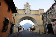 Volcan de Agua, the Volcano of Water, 3766m, dominates views to the south of Antigua Guatemala. Here it ican be seen through  Arco de Santa Catalina, the Santa Catalina Arch on  5 Avenida Sur. Antigua Guatemala, Republic of Guatemala. 02Mar14