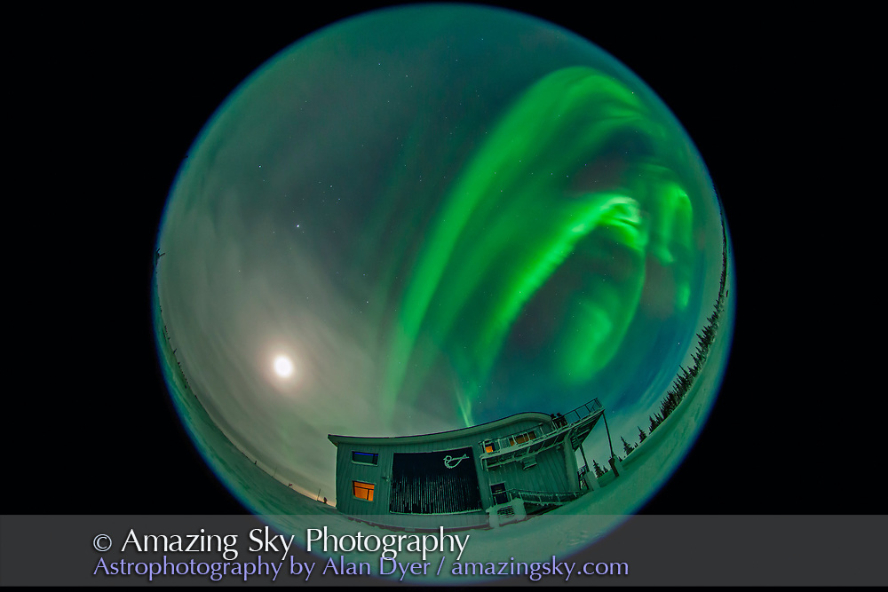 The aurora of February 7, 2014 seen from Churchill, Manitoba at the Churchill Northern Studies Centre, in a view looking west with the 8mm lens. Some aurora tour group members are on the second floor observing deck. This is a 7-second exposure at f/3.5 and ISO 1250 wth the Canon 5D MkII. It is one frame of 349 in a time-lapse sequence.