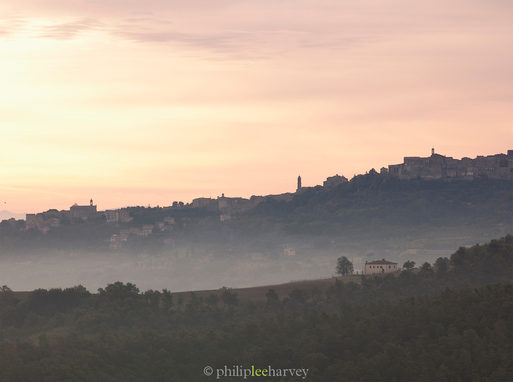 A misty dawn over the Tuscan landscape at Montepulciano, Italy