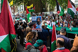 London, UK. 10th June, 2018. Hundreds of people with a 70-metre Palestinian flag wait outside the Saudi embassy to take part in the pro-Palestinian Al Quds Day march through central London organised by the Islamic Human Rights Commission. An international event, it began in Iran in 1979. Quds is the Arabic name for Jerusalem.