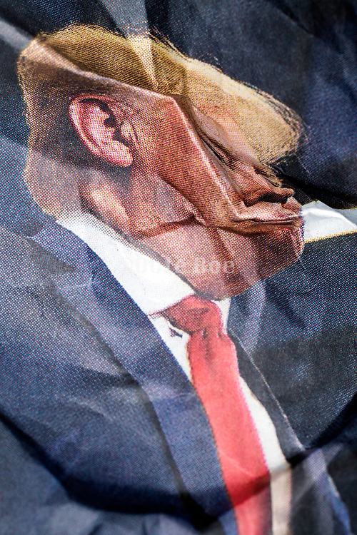 crumpled newspaper print with US president Donald Trump