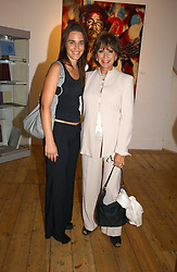 Left to right, ROBYN GARRATT and EVIE BRICUSSE at a private view of artist Adam Bricusse's paintings entitles 'The Mysteries Within' held at the Charing X Gallery, 121-125 Charing Cross Road, London WC2 on 12th September 2006.<br /><br />NON EXCLUSIVE - WORLD RIGHTS