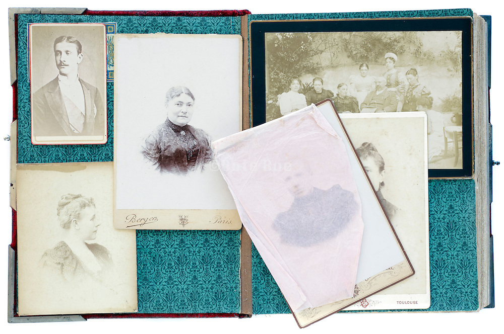 open vintage family photo album from late 1800s with portraits and carte de visites