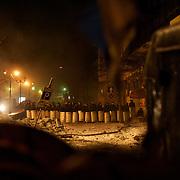 January 24, 2014 - Kiev, Ukraine: Ukrainian riot police stands position near a protestor's barricade beside Dynamo Kiev's stadium in central Kiev, as temperatures drop to minus 15 degrees celsius. (Paulo Nunes dos Santos)