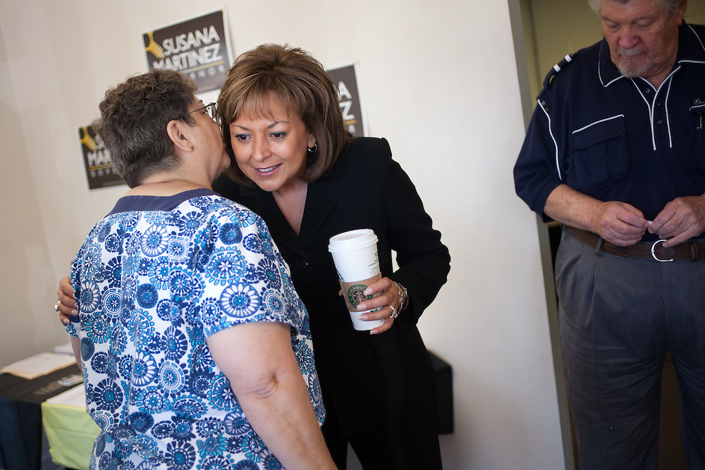 ALBUQUERQUE, NM - OCTOBER, 13: Volunteer Nora Malin whispers in the ear of Republican gubernatorial candidate Susana Martinez at her campaign headquarters on October 13, 2010 in Albuquerque New Mexico. (Photo by Steven St. John/For The Washington Post)