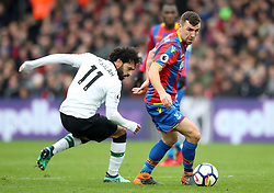 Liverpool's Mohamed Salah (left) and Crystal Palace's James McArthur battle for the ball during the Premier League match at Selhurst Park, London.