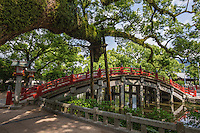 """Taikobashi Bridge spans over Shinjiike Pond represents the past, the present, and the future.  Shinjiike Pond is shaped to resemble the Chinese character for """"heart""""."""