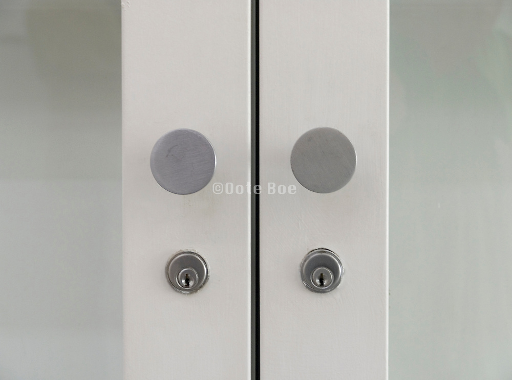 extreme close up of doorknobs with locks