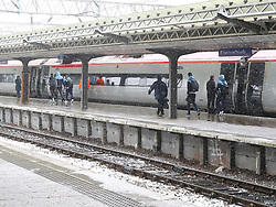 The Manchester City team are seen at Manchester Piccadilly Train Station on Thursday morning as they make their trip to London to face Arsenal in the premier league