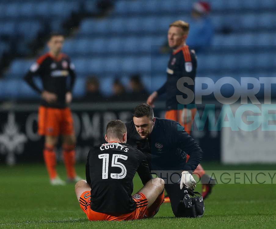 Paul Coutts of Sheffield Utd receives treatment during the English League One match at the Rioch Arena Stadium, Coventry. Picture date: December 15th, 2016. Pic Simon Bellis/Sportimage