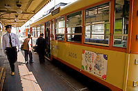 Japanese streetcar conductor - The easiest and most convenient form of transportation in Matsuyama is by streetcar. One line runs from Matsuyama Station to the Okaido arcade, passing by Matsuyama Castle, and Dogo Onsen as its terminus.