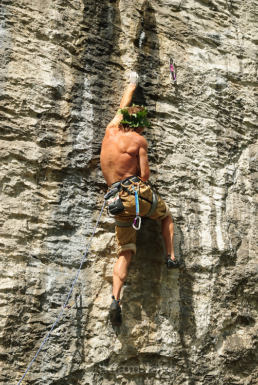 Ben Bransby sporting a sycamore-leaf sun-hat whilst sport climbing at Rubicon Wall, Peak District