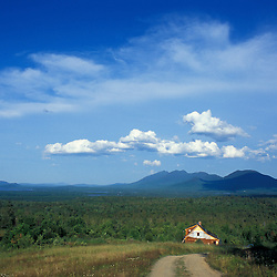 Eustis, ME. A summer home being built in the north woods of Maine.  The Bigelow Range and Flagstaff Lake are in the distance.