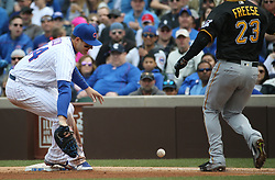 April 14, 2017 - Chicago, IL, USA - Chicago Cubs first baseman Anthony Rizzo (44) makes a fielding error, allowing the Pittsburgh Pirates' David Freese (23) to reach safely in the fourth inning at Wrigley Field in Chicago on Friday, April 14, 2017. The Pirates won, 4-2. (Credit Image: © John J. Kim/TNS via ZUMA Wire)