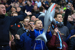 28 October 2017 -  Premier League - West Bromwich Albion v Manchester City - A young Manchester City city waves an inflatable Shark - Photo: Marc Atkins/Offside