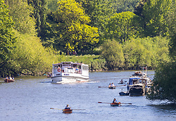 Licensed to London News Pictures. 30/05/2021. London, UK. Sun starved Brits flock to the Thames at Richmond, southwest London this afternoon as the glorious sunny weather continues. The Met Office have forecast warm weather and sunshine for the South East and London over the Bank Holiday weekend with temperatures predicted to hit up to 24c for Bank Holiday Monday. Photo credit: Alex Lentati/LNP