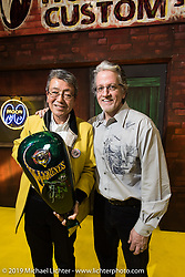Mooneyes Shige Suganuma with HD's head of design Ray Drea and the award Ray painted and presented to him at the Annual Mooneyes Yokohama Hot Rod and Custom Show. Japan. Sunday, December 7, 2014. Photograph ©2014 Michael Lichter.