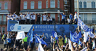 Brighton players on open top bus and Brighton & Hove Albion central midfielder Steve Sidwell (14) with trophy during the Brighton & Hove Albion Football Club Promotion Parade at Brighton Seafront, Brighton, United Kingdom on 14 May 2017. Photo by Phil Duncan.