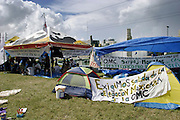 12 SEPTEMBER 2003 - CANCUN, QUINTANA ROO, MEXICO: A camp for anti-globalization protestors at the entrance to the hotel/tourist zone in Cancun, Mexico. Protestors are camped out throughout downtown Cancun. Thousands of anti-globalization protestors have come to Cancun to try to disrupt the 5th Ministerial meeting of the World Trade Organization. The protestors have been restricted to downtown Cancun, while the WTO is meeting 10 miles away in the Cancun tourist zone. PHOTO BY JACK KURTZ