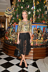 POPPY DELEVINGNE at the Claridge's Christmas Tree By Dolce & Gabbana Launch Party held at Claridge's, Brook Street, London on 26th November 2013.