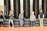 Nederland, Veghel, 20101117.?Kinderen op de creche met leidster. In de gymzaal. rond rennen. bewogen kinderen. lichamelijke oefeningen. ?Kinderopvang 't Kroontje in Veghel...Netherlands, Veghel, 20101117. ?Boy at the nursery with kindergarten teacher. In the gym. running around. moving children. physical exercises.?Childcare t Kroontje in Veghel..