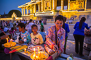"""30 JANUARY 2013 - PHNOM PENH, CAMBODIA: Cambodians light incense and candles for late Cambodian King Norodom Sihanouk in Phnom Penh. Sihanouk (31 October 1922- 15 October 2012) was the King of Cambodia from 1941 to 1955 and again from 1993 to 2004. He was the effective ruler of Cambodia from 1953 to 1970. After his second abdication in 2004, he was given the honorific of """"The King-Father of Cambodia."""" Sihanouk held so many positions since 1941 that the Guinness Book of World Records identifies him as the politician who has served the world's greatest variety of political offices. These included two terms as king, two as sovereign prince, one as president, two as prime minister, as well as numerous positions as leader of various governments-in-exile. He served as puppet head of state for the Khmer Rouge government in 1975-1976. Most of these positions were only honorific, including the last position as constitutional king of Cambodia. Sihanouk's actual period of effective rule over Cambodia was from 9 November 1953, when Cambodia gained its independence from France, until 18 March 1970, when General Lon Nol and the National Assembly deposed him. Upon his final abdication, the Cambodian throne council appointed Norodom Sihamoni, one of Sihanouk's sons, as the new king. Sihanouk died in Beijing, China, where he was receiving medical care, on Oct. 15, 2012. His cremation is scheduled to take place on Feb. 4, 2013. Over a million people are expected to attend the service.        PHOTO BY JACK KURTZ"""