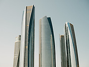 View of the top of the buildings of the futuristic Etihad Towers.