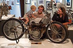 Bill Rodencal and Matt Olsen watch Matt's son, Lock, ride Bill's Model 11-KR Harley-Davidson in the Naked Truth exhibition at the Buffalo Chip. SD, USA.  August 2, 2015.  Photography ©2015 Michael Lichter.
