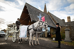 © Licensed to London News Pictures . 30/10/2018. Accrington , UK . Gemma's carriage , lead by two white horses dressed in pink and blue feathers , outside the crematorium , during the service . The funeral of Gemma Nuttall at Accrington Crematorium . Gemma died of cancer despite initially seeing off the disease after radical immunotherapy treatment in Germany , paid for with the fundraising support of actress Kate Winslet , who read of Gemma's plight on a crowdfunding website shortly after she lost her own mother to cancer . Permission to photograph given by Gemma's mother , Helen Sproates . Photo credit : Joel Goodman/LNP