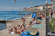 BY THE SEA - PIRAN - colour photo art pictures by Paul Williams of tourists enjoying a day in the sun by the sea. Taken in 2007 .<br /> <br /> Visit our REPORTAGE & STREET PEOPLE PHOTO ART PRINT COLLECTIONS for more wall art photos to browse https://funkystock.photoshelter.com/gallery-collection/People-Photo-art-Prints-by-Photographer-Paul-Williams/C0000g1LA1LacMD8