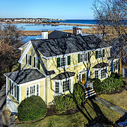 In addition to showing this lovely home's architectural beauty and proximity to the water in one image, this real estate marketing photo also shows that it is possible to shoot in the winter. It was taken in mid December when the temperature was in the high teens.