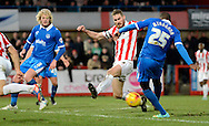 Nigel Atangana shoots and scores the equaliser during the Sky Bet League 2 match between Cheltenham Town and Portsmouth at Whaddon Road, Cheltenham, England on 20 December 2014. Photo by Alan Franklin.