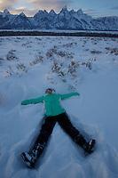 Jessica Laman (age 9) makes a snow angel below the Tetons.<br />Grand Teton National Park, Wyoming