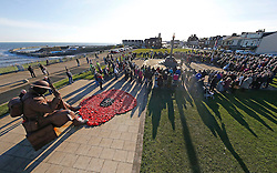 Two minutes' silence is observed at the Tommy Statue in Seaham, Co Durham, to mark Armistice Day, the anniversary of the end of the First World War.