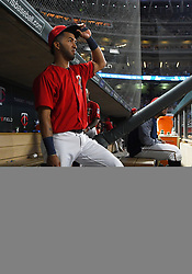 May 18, 2018 - Minneapolis, MN, U.S. - MINNEAPOLIS, MN - MAY 18: Minnesota Twins Left field Eddie Rosario (20) looks on from the dugout during a MLB game between the Minnesota Twins and Milwaukee Brewers on May 18, 2018 at Target Field in Minneapolis, MN. The Brewers defeated the Twins 8-3.(Photo by Nick Wosika/Icon Sportswire) (Credit Image: © Nick Wosika/Icon SMI via ZUMA Press)