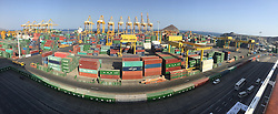 Pic from a panoramic photo from an iPhone6 of the container port at Muscat. Images from the MSC Musica cruise to the Persian Gulf, visiting Abu Dhabi, Khor al Fakkan, Khasab, Muscat, and Dubai, traveling from 13/12/2015 to 20/12/2015.
