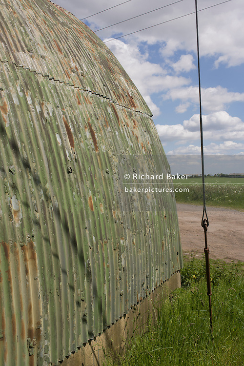 An old arched corrugated shelter in a rural place<br /> near Halstow on the Kent Thames estuary marshes, potentially threatened by the future London airport.
