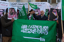 Pro-Saudi counter demonstrators wave their Saudi flags and sing and dance as Protesters demonstrate on Whitehall in London on behalf of Yemen and against the visit to the UK by protest against Saudi Crown Prince Mohammad Bin Salman. London, March 07 2018.