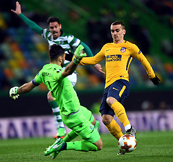 LISBON, April 13, 2018  Antoine Griezmann (R) of Atletico shoots during the Europa League quarterfinal second leg soccer match between Sporting CP and Club Atletico de Madrid at the Jose Alvalade stadium in Lisbon, Portugal, on April 12, 2018. Sporting won 1-0 but was eliminated by a 1-2 on aggregate. (Credit Image: © Zhang Liyun/Xinhua via ZUMA Wire)