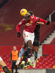 MANCHESTER, ENGLAND - Friday, January 1, 2020: Manchester United's Paul Pogba heads the ball clear during the New Year's Day FA Premier League match between Manchester United FC and Aston Villa FC at Old Trafford. The game was played behind closed doors due to the UK government putting Greater Manchester in Tier 4: Stay at Home during the Coronavirus COVID-19 Pandemic. (Pic by David Rawcliffe/Propaganda)