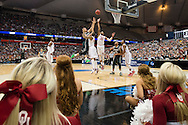 27 MAR 2015: Gavin Schilling of Michigan State University shoots over TaShawn Thomas (35) of the University of Oklahoma during the 2015 NCAA Men's Basketball Tournament held at the Carrier Dome in Syracuse, NY. Michigan State defeated Oklahoma 62-58. Brett Wilhelm/NCAA Photos