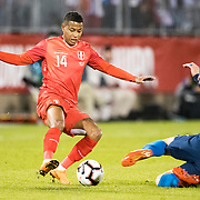 EAST HARTFORD, CONNECTICUT- October 16th: Andy Polo #14 of Peru is challenged by Ben Sweat #19 of the United States during the United States Vs Peru International Friendly soccer match at Pratt & Whitney Stadium, Rentschler Field on October 16th 2018 in East Hartford, Connecticut. (Photo by Tim Clayton/Corbis via Getty Images)