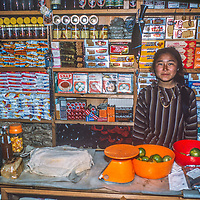 As a young woman in 1986, Nawang Doka Sherpani helps her family manage a store in Namche Bazar, Nepal during a break from university studies in Kathmandu.  She later trained in Canada to become a dentist and still practices in the Khumbu region.