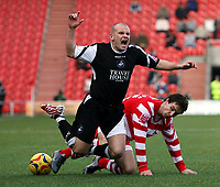 Photo: Paul Thomas.<br />Doncaster Rovers v Swansea City. Coca Cola League 1. 17/02/2007.<br /><br />Andy Robinson (Black) of Swansea is tackled by Mark Wilson.