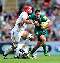 Leicester Tigers centre Dan Bowden looks to get past Worcester Warriors flanker Jonathan Thomas - Photo mandatory by-line: Patrick Khachfe/JMP - Tel: Mobile: 07966 386802 - 08/09/2013 - SPORT - RUGBY UNION - Welford Road Stadium - Leicester Tigers v Worcester Warriors - Aviva Premiership.