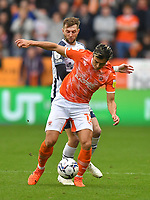 Blackpool's Kenny Dougall battles with Preston North End's Tom Barkhuizen<br /> <br /> Photographer Dave Howarth/CameraSport<br /> <br /> The EFL Sky Bet Championship - Blackpool v Preston North End - Saturday 23rd October 2021 - Bloomfield Road - Blackpool<br /> <br /> World Copyright © 2020 CameraSport. All rights reserved. 43 Linden Ave. Countesthorpe. Leicester. England. LE8 5PG - Tel: +44 (0) 116 277 4147 - admin@camerasport.com - www.camerasport.com