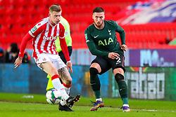 Matt Doherty of Tottenham Hotspur turns the ball infield, pressured by James McClean of Stoke City  - Mandatory by-line: Nick Browning/JMP - 23/12/2020 - FOOTBALL - Bet365 Stadium - Stoke-on-Trent, England - Stoke City v Tottenham Hotspur - Carabao Cup