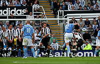 Photo: Andrew Unwin.<br />Newcastle United v Manchester City. The Barclays Premiership. 24/09/2005.<br />Manchester City's Richard Dunne (#22) fires his free-kick into the crowd.