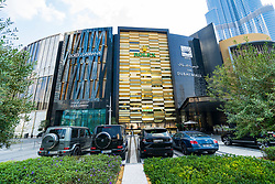 Exterior of Dubai Mall Fashion Avenue with valet parked expensive cars outside , Downtown Dubai, United Arab Emirates