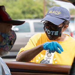 NAACP volunteers help register Travis County, Texas voters in east Austin during a push to engage voters before the early October deadline. Texas, usually a solid Republican stronghold, might prove to be a battleground on November 3rd.